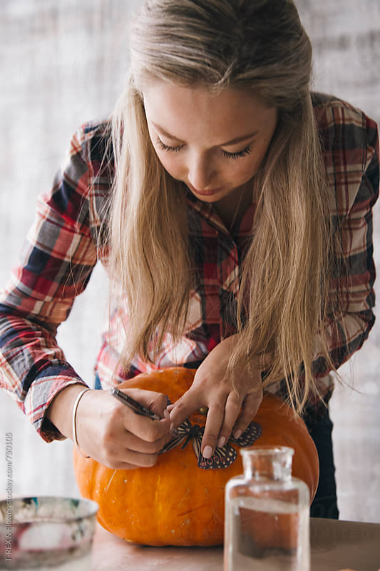 Woman decorating pumpkin using decoupage technique by T-REX & Flower for Stocksy United