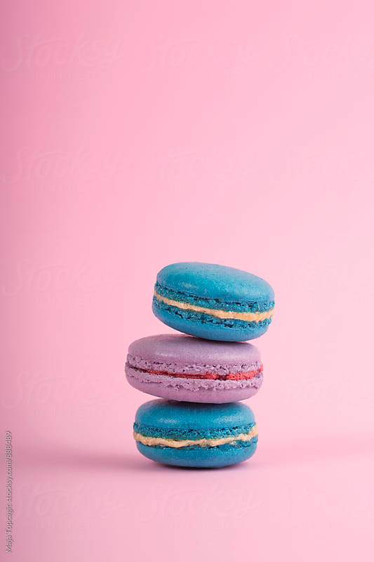 Delicious colorful macaroons on a pink background by Maja Topcagic for Stocksy United