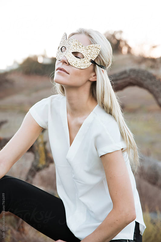 Woman wearing cat mask by Ivan Solis for Stocksy United