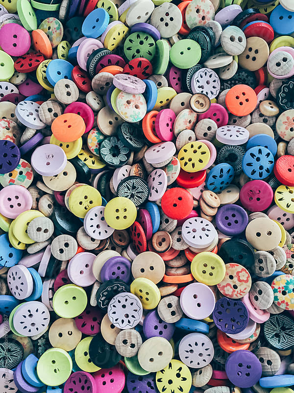 Background or texture of a pile of buttons of many colors by Vera Lair for Stocksy United