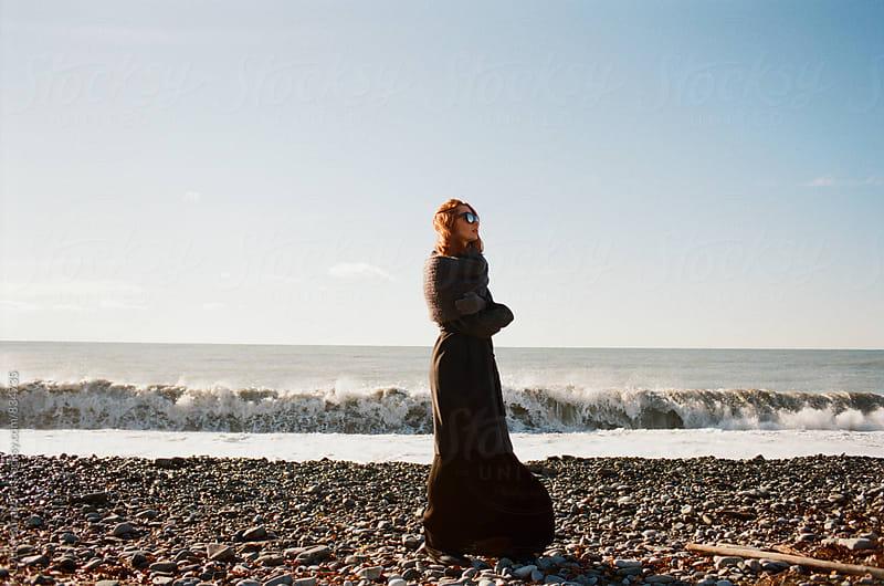 Woman standing at seashore  by Lyuba Burakova for Stocksy United
