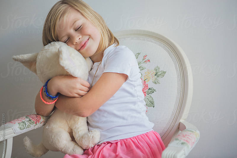 Girl Hugging Her Toy Dog by Lumina for Stocksy United