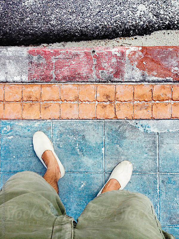 Man Wearing Espadrilles on Colored Sidewalk by VISUALSPECTRUM for Stocksy United