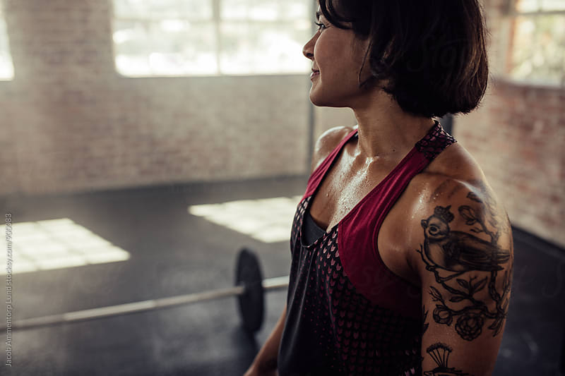 Tattooed woman at gym by Jacob Lund for Stocksy United