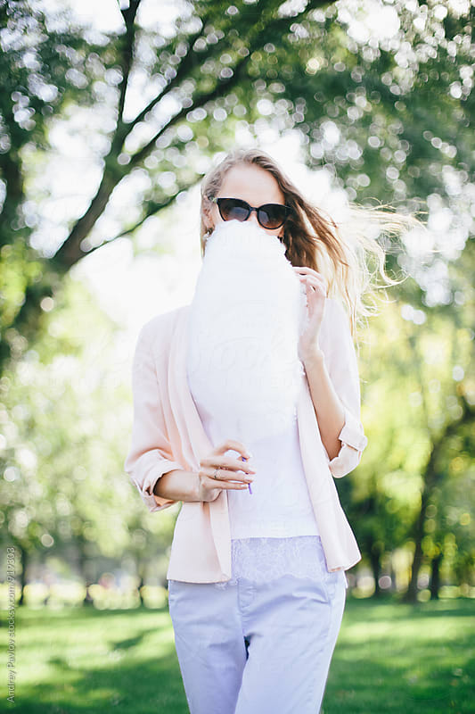 Woman peep out of cotton candy by Andrey Pavlov for Stocksy United