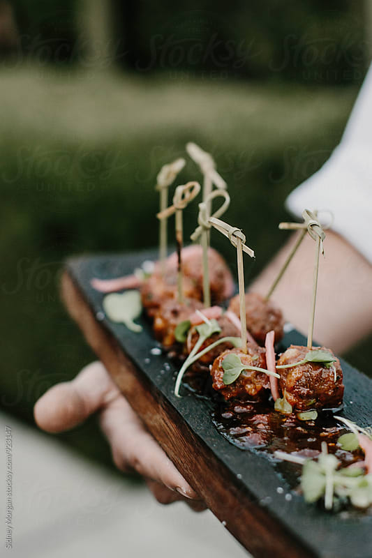 Meatballs on a Tray by Sidney Morgan for Stocksy United