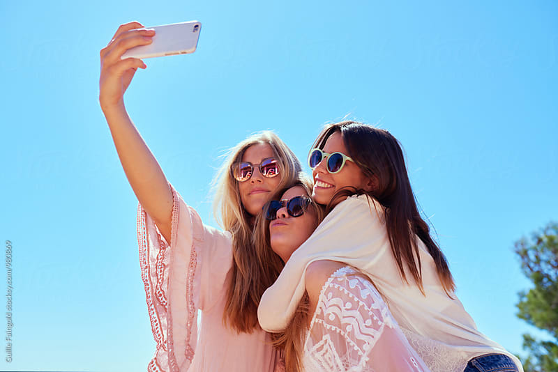 Three beautiful girls making selfie by Guille Faingold for Stocksy United