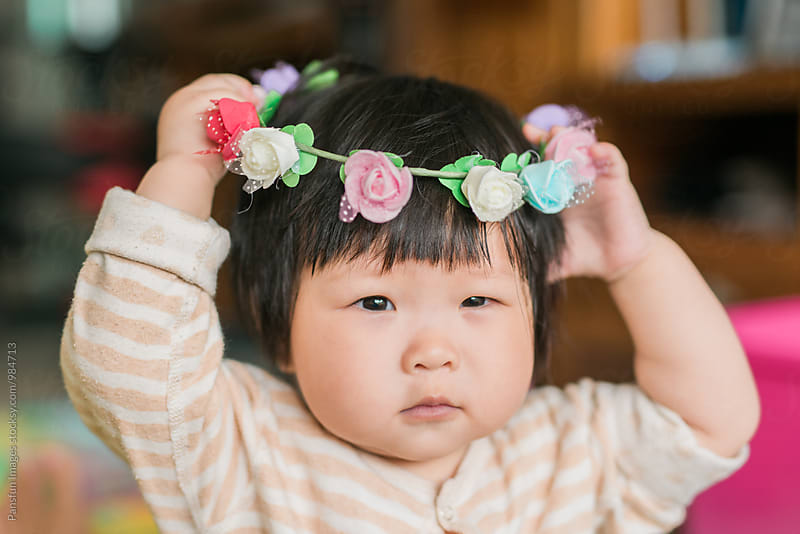 baby girl with wreath by Pansfun Images for Stocksy United