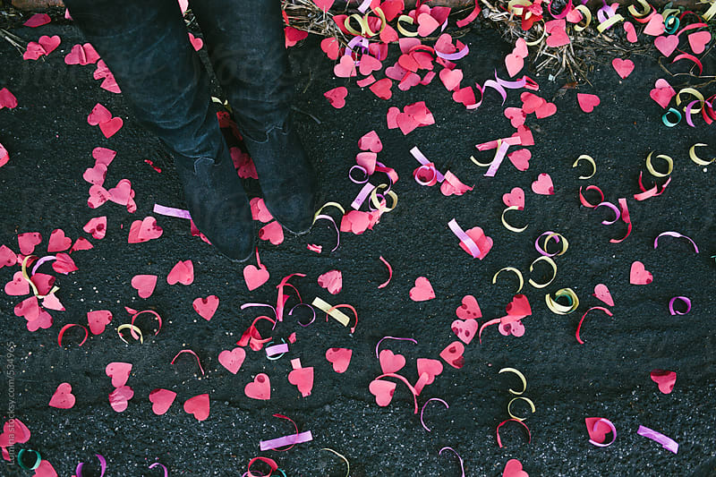 Woman Standing on Heart-Shaped Confetti by Lumina for Stocksy United