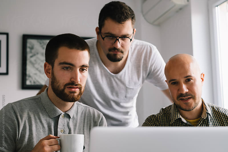 Three Male Colleagues Working At the Office by Katarina Radovic for Stocksy United