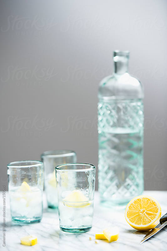 Vodka lemon on the rocks by Cameron Whitman for Stocksy United