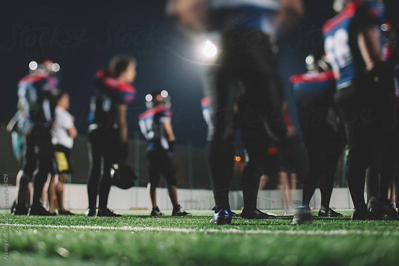 American football players. by Alexey Kuzma for Stocksy United