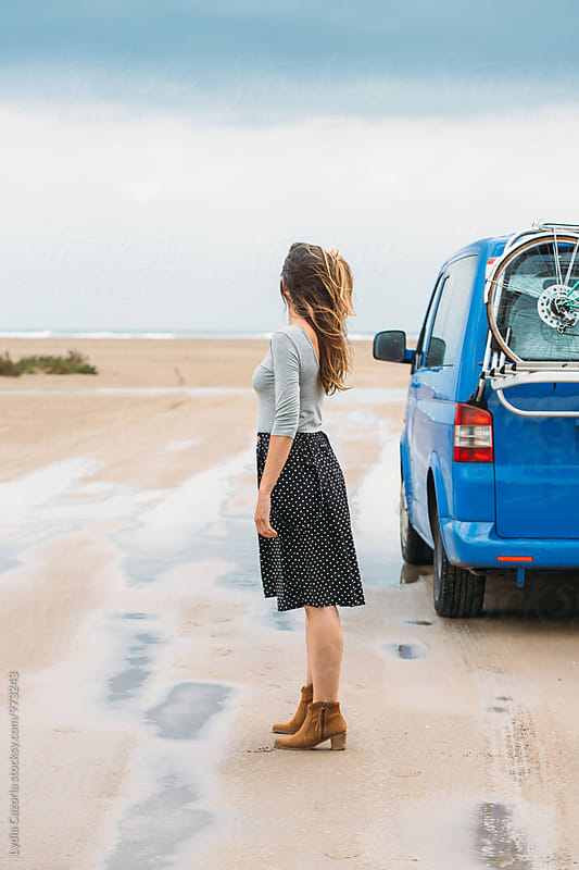 Woman watching  the beach while their hair fly with your van by Lydia Cazorla for Stocksy United