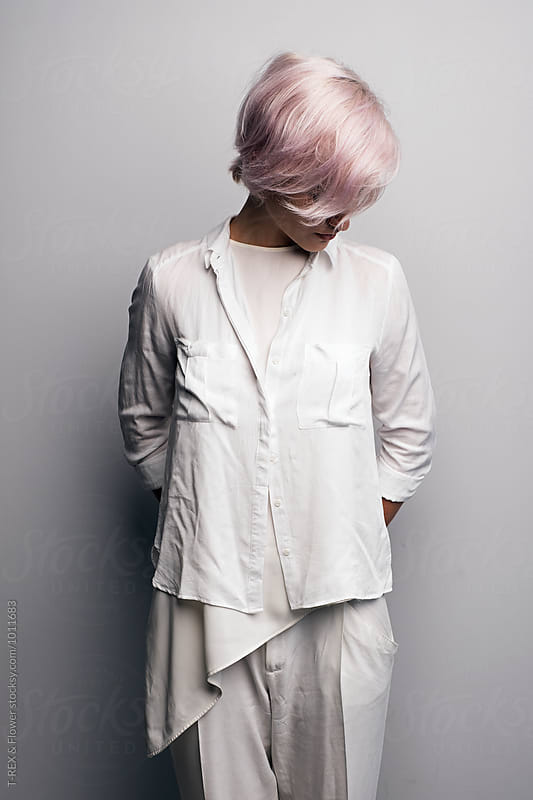 Pink-haired model looking down by T-REX & Flower for Stocksy United