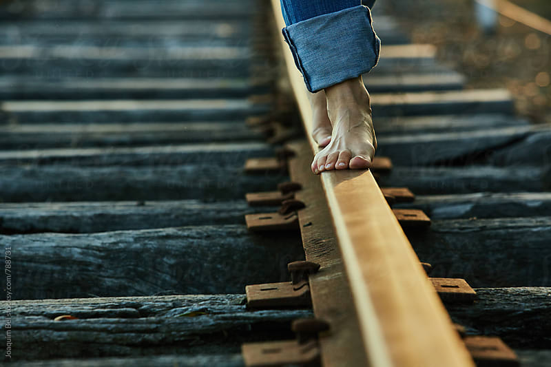 Feet on the train tracks by Joaquim Bel for Stocksy United