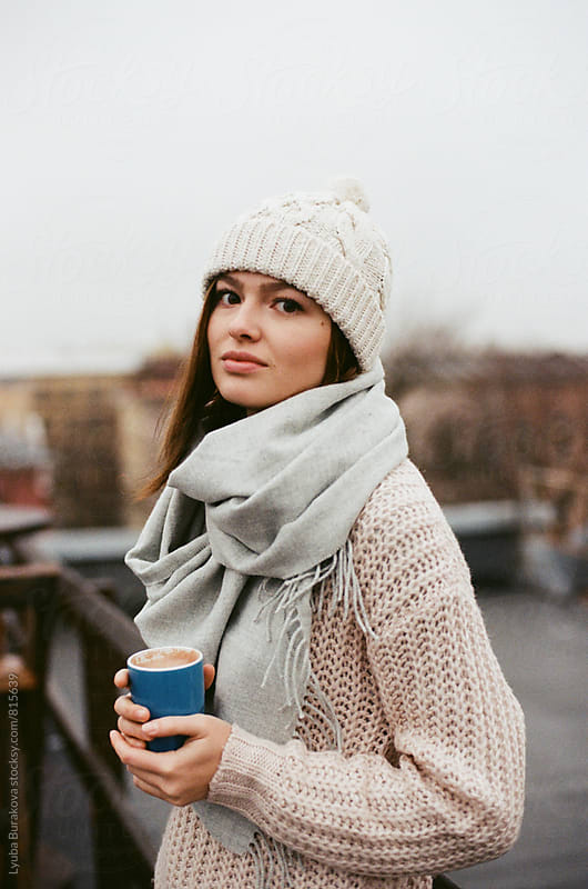 Young woman with cup of coffee outdoors by Lyuba Burakova for Stocksy United