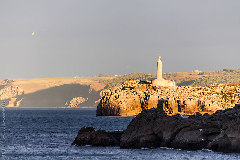 Lighthouse Bathed in Evening Light by Marilar Irastorza for Stocksy United