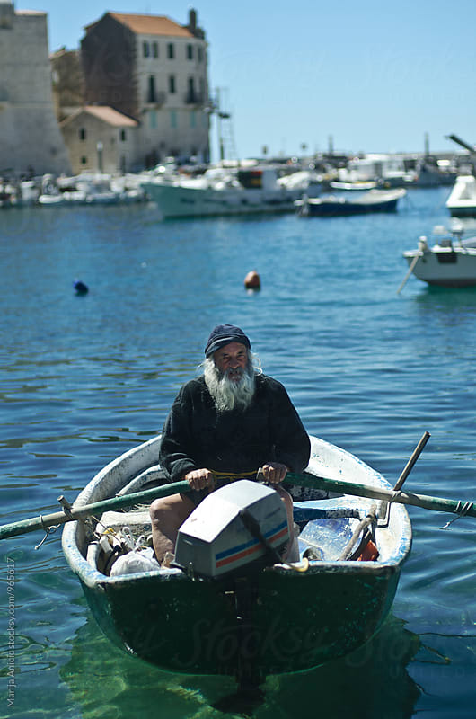 Old fisherman by Marija Anicic for Stocksy United