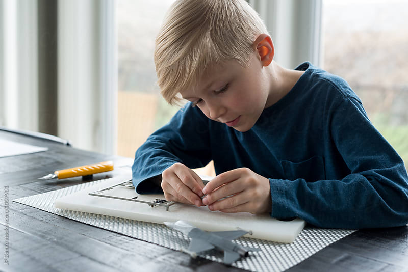 Little Boy Putting Together Model Airplane Educational Hobby by JP Danko for Stocksy United