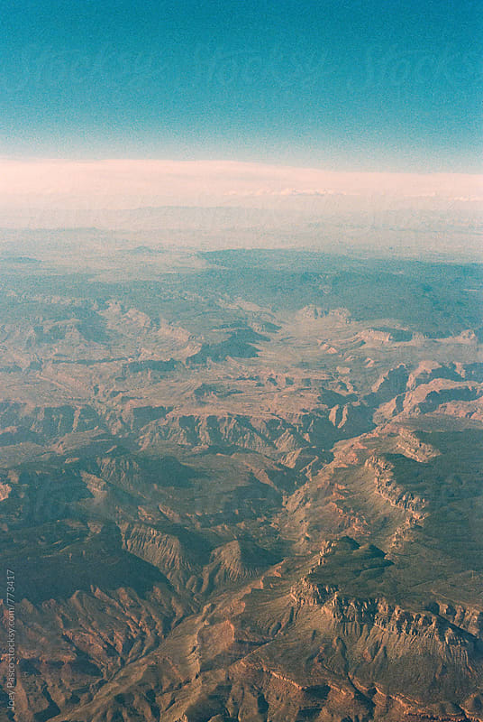 Birds-eye view of Arizona desert / Grand Canyon region from airplane by Joey Pasco for Stocksy United