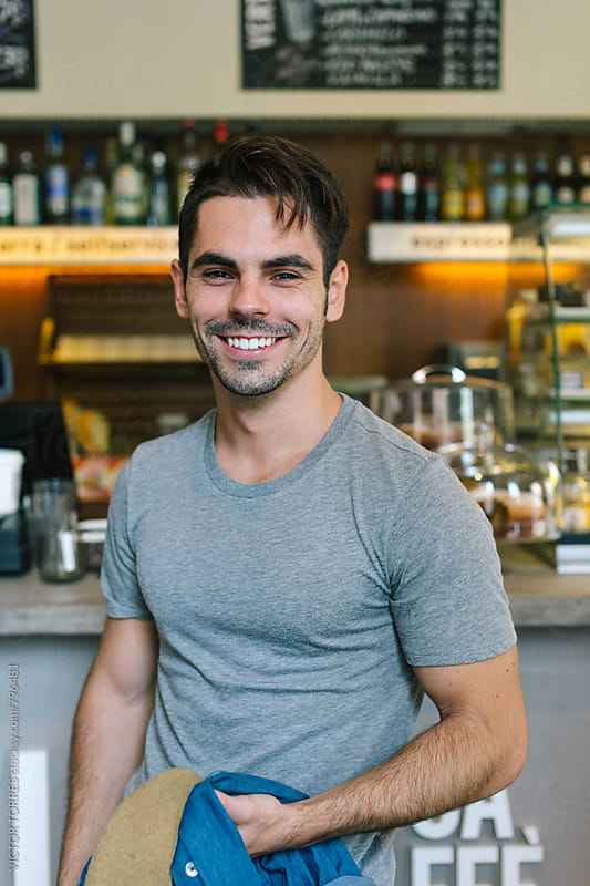 Portrait of a Happy Man in a Bar by Victor Torres for Stocksy United