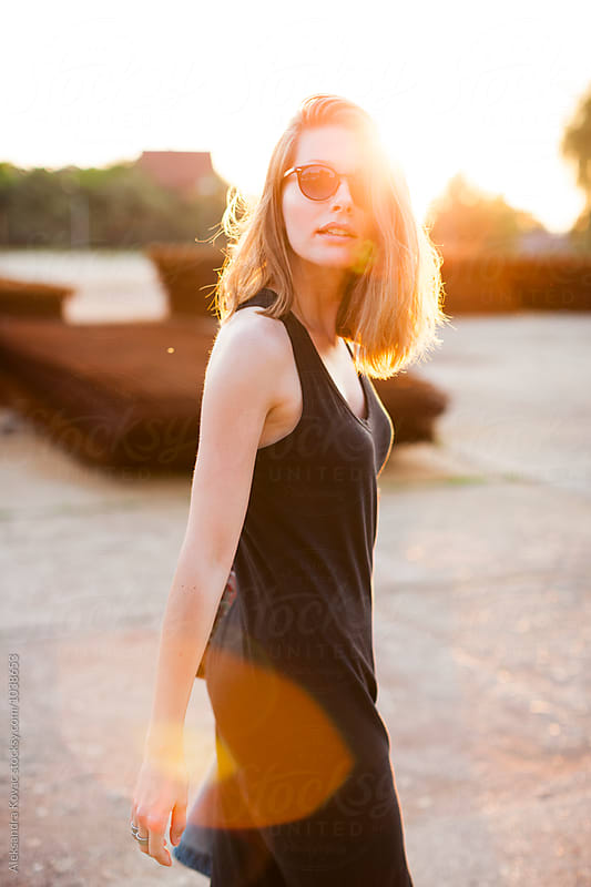 Beautiful woman at sunset by Aleksandra Kovac for Stocksy United