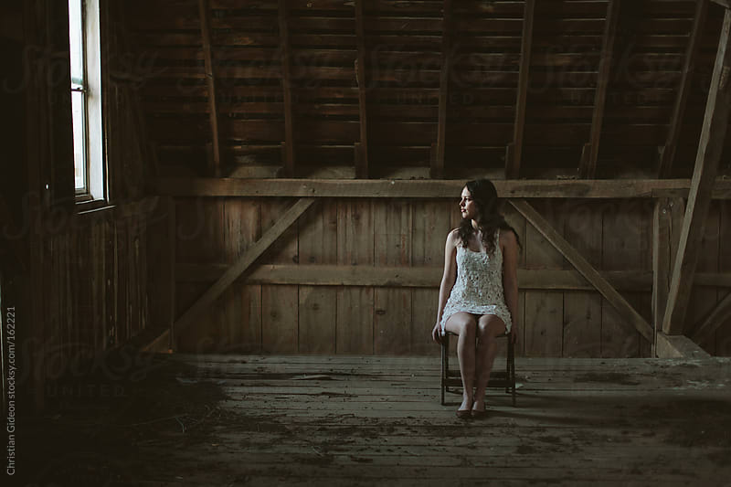 Portrait in Abandoned Barn by Christian Gideon for Stocksy United