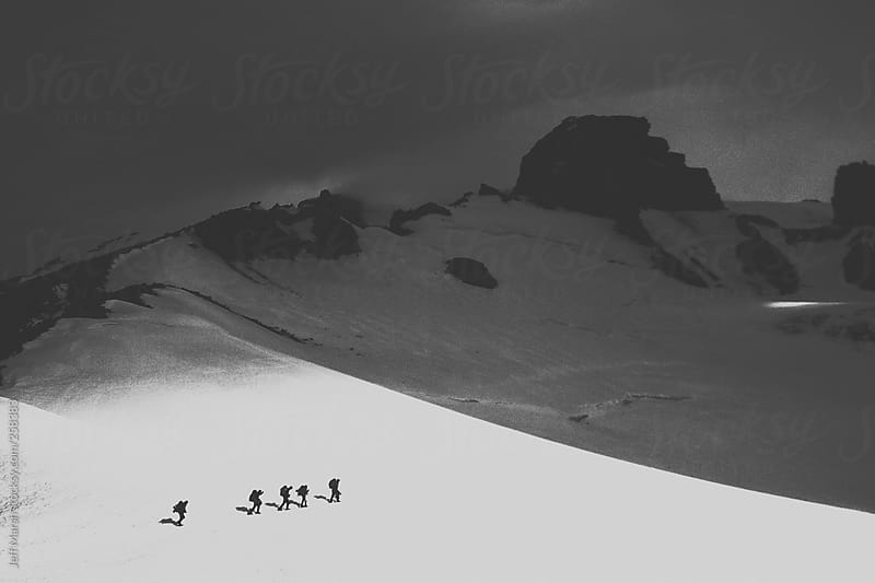 Climbers crossing glacier by Jeff Marsh for Stocksy United