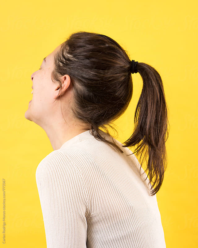 Woman laughing from behind by Carles Rodrigo Monzo for Stocksy United
