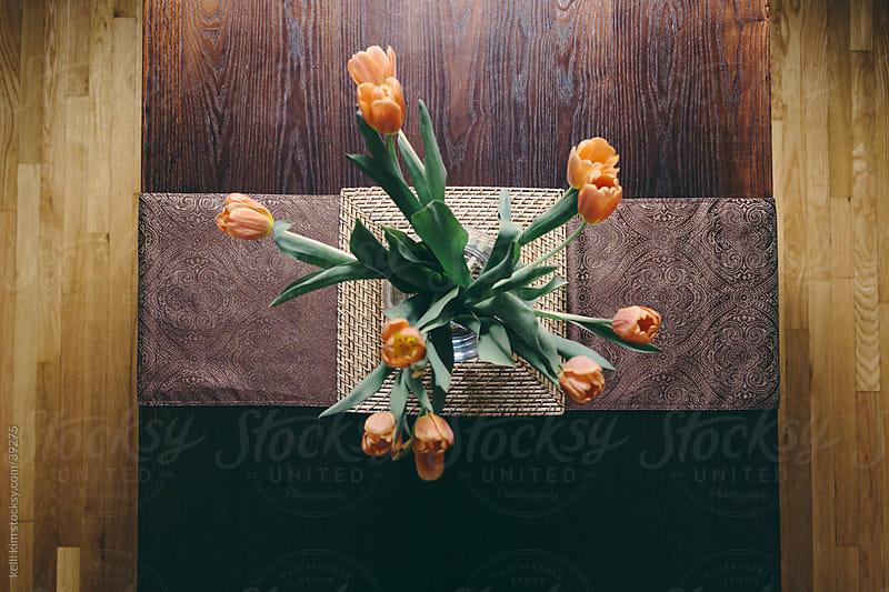 Orange Tulips In Vase On Wood Table by kelli kim for Stocksy United