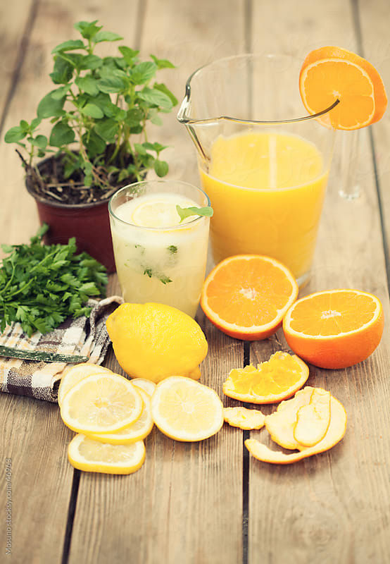 Freshly made citrus juice with mint leaves.  by Mosuno for Stocksy United