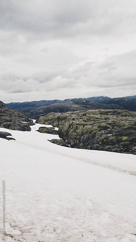 Hike trail in Norway is partially snow-covered. by Kaat Zoetekouw for Stocksy United