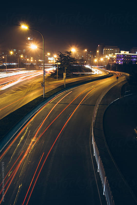 Car lights at night in Beijing, long exposure by zheng long for Stocksy United