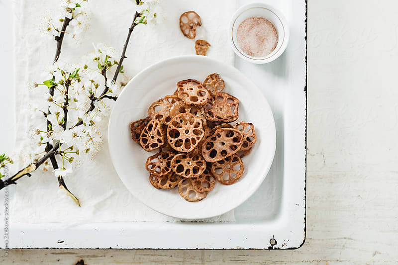 Lotus root chips by Tatjana Ristanic for Stocksy United