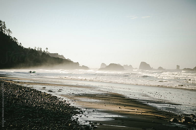 Surfers entering the Water in the Distance by Kristine Weilert for Stocksy United