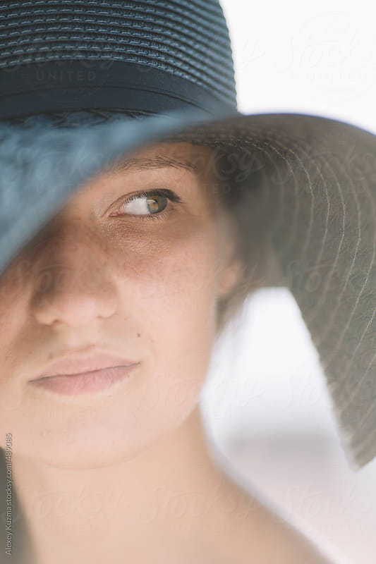 young woman with black hat,natural light by Alexey Kuzma for Stocksy United
