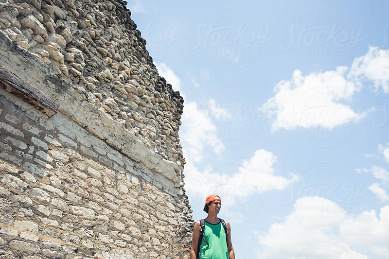 Man with Mayan Temple Wall by MEGHAN PINSONNEAULT for Stocksy United