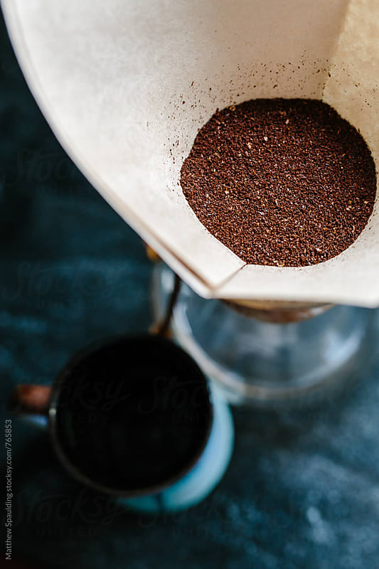 Mug and fresh coffee grounds in filter for home brew by Matthew Spaulding for Stocksy United