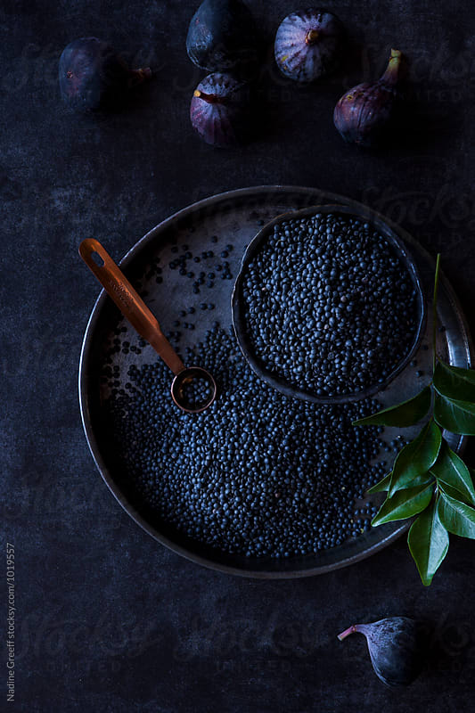 Black beluga lentils and figs by Nadine Greeff for Stocksy United