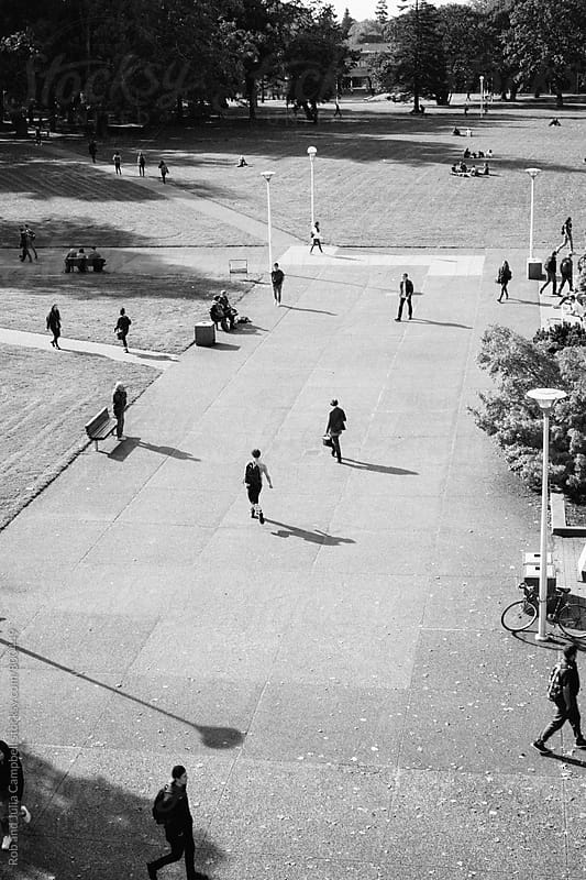 High view of people - students -  walking on college campus by Rob and Julia Campbell for Stocksy United