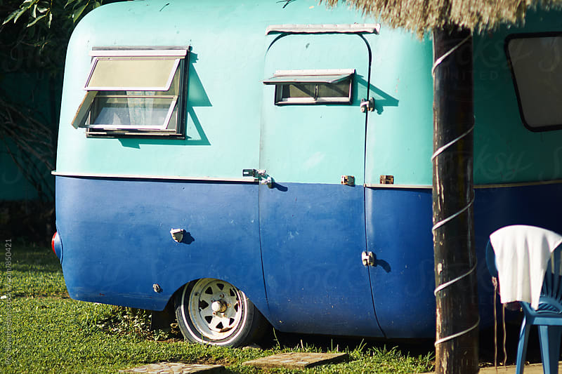 Turqoise parked vintage camper by Per Swantesson for Stocksy United