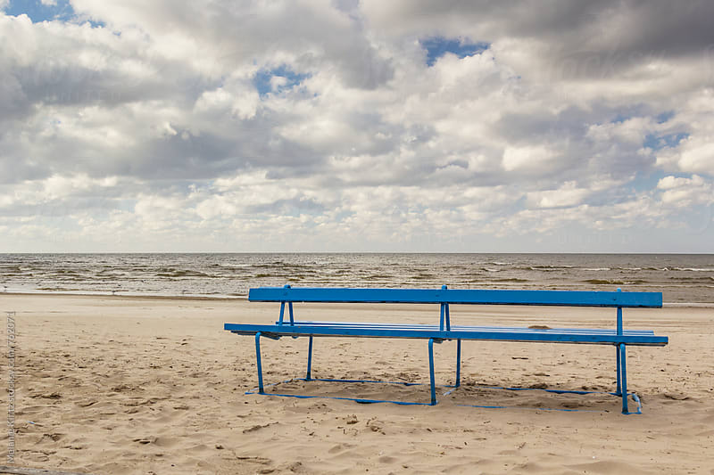 Latvia, Jurmala - Typical Blue Bench at the beach of Jurmala by Melanie Kintz for Stocksy United
