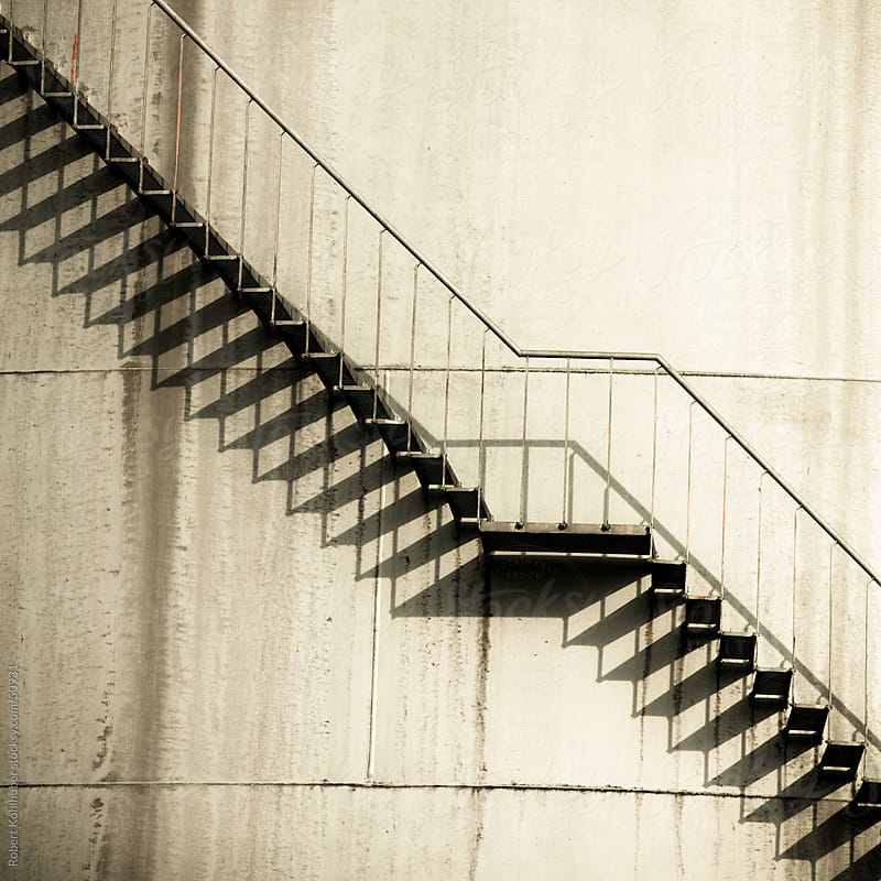 Stairs at storage tank by Robert Kohlhuber for Stocksy United