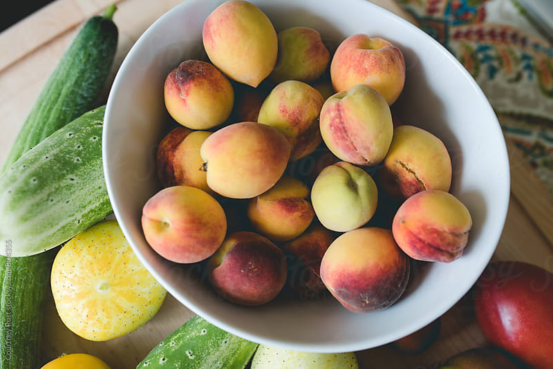 bowl full of peaches by Courtney Rust for Stocksy United