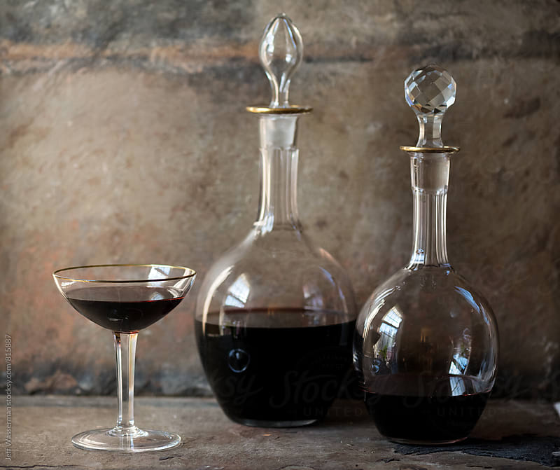 Decanters and glass of  Red Wine by Jeff Wasserman for Stocksy United