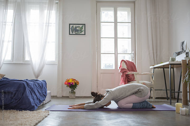 Asian Woman Doing Yoga at Home by Lumina for Stocksy United