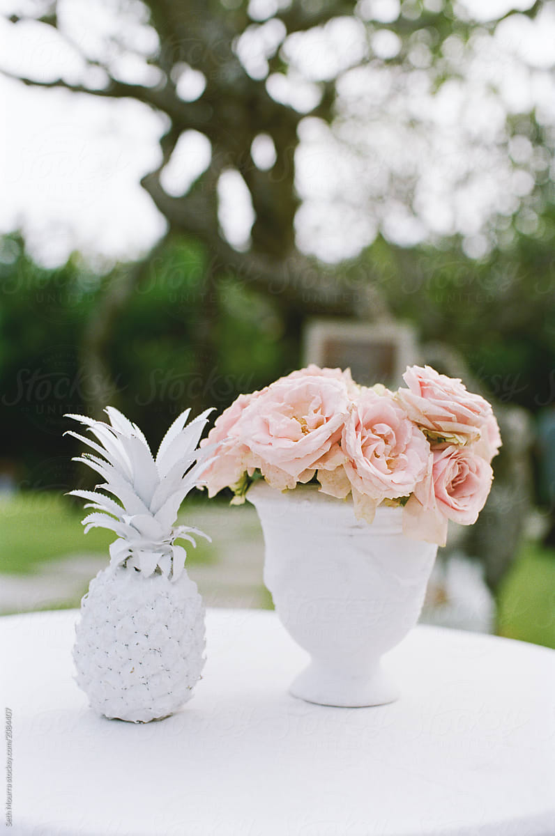 Outdoor Tropical Wedding Guest Table With Pink Flower Arrangement