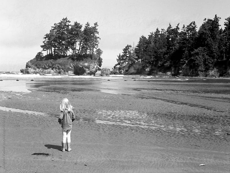 Film Shot of little Girl standing on Striking Beach Landscape by Amanda Voelker for Stocksy United