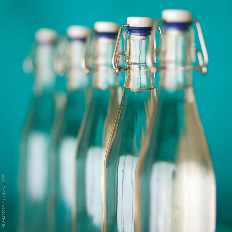 Row of Glass Bottles by VISUALSPECTRUM for Stocksy United