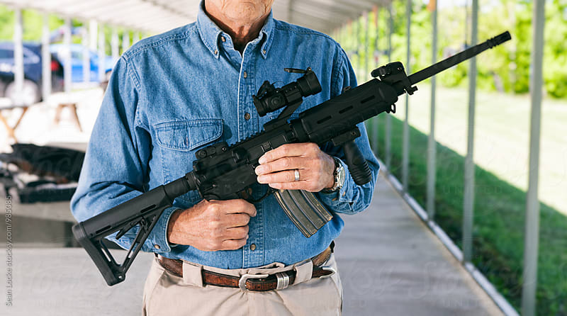 stock photo: holding rifle